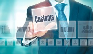A-businessman-selecting-a-Customs-Concept-button-on-a-clear-screen..jpg